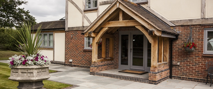 Making an entrance complete your home with a beautiful for Oak framed house designs