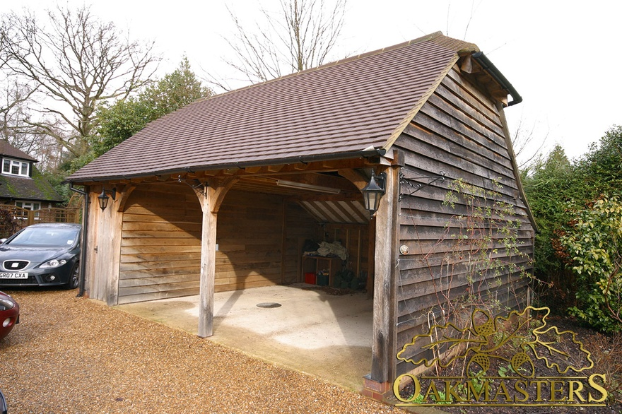 Two bay open oak framed garage with barn hip and cat slide for 2 bay garage