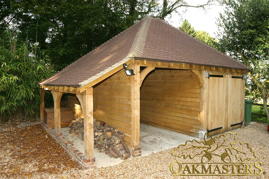 2 bay semi closed oak garage with log store oakmasters for Tre bay garage