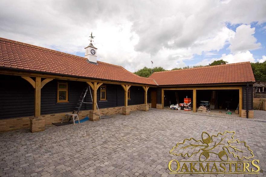 3 bay oak framed garage extension in essex oakmasters for Three bay garage