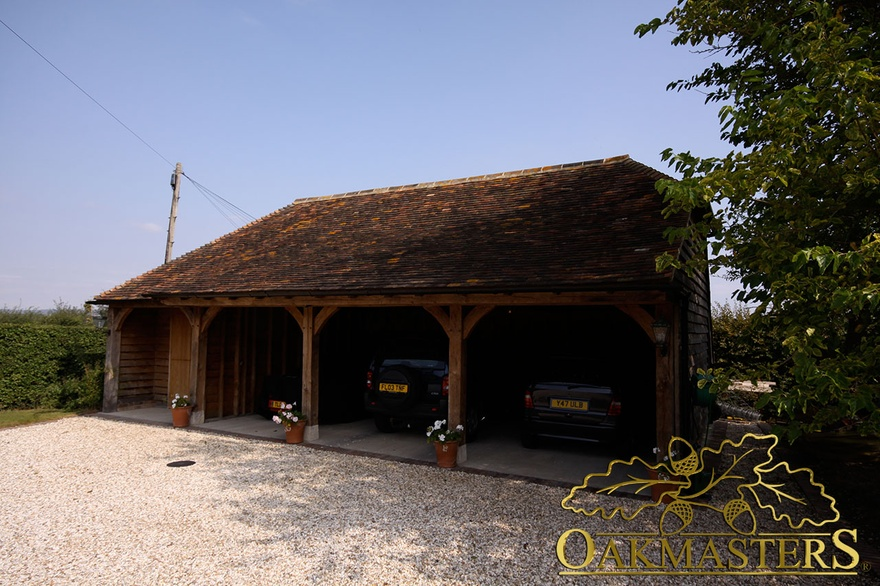 3 bay open oak garage with closed store room oakmasters for Three bay garage