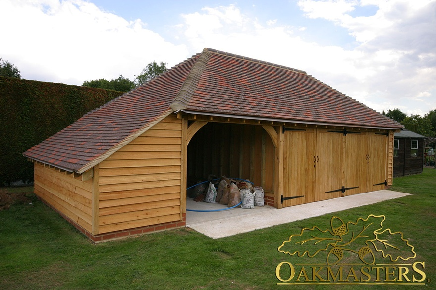 3 bay semi open garage with enclosed log store oakmasters for Due bay garage