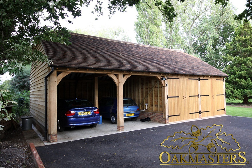 Two open and two closed oak garage bays 5018 oakmasters for 2 bay garage