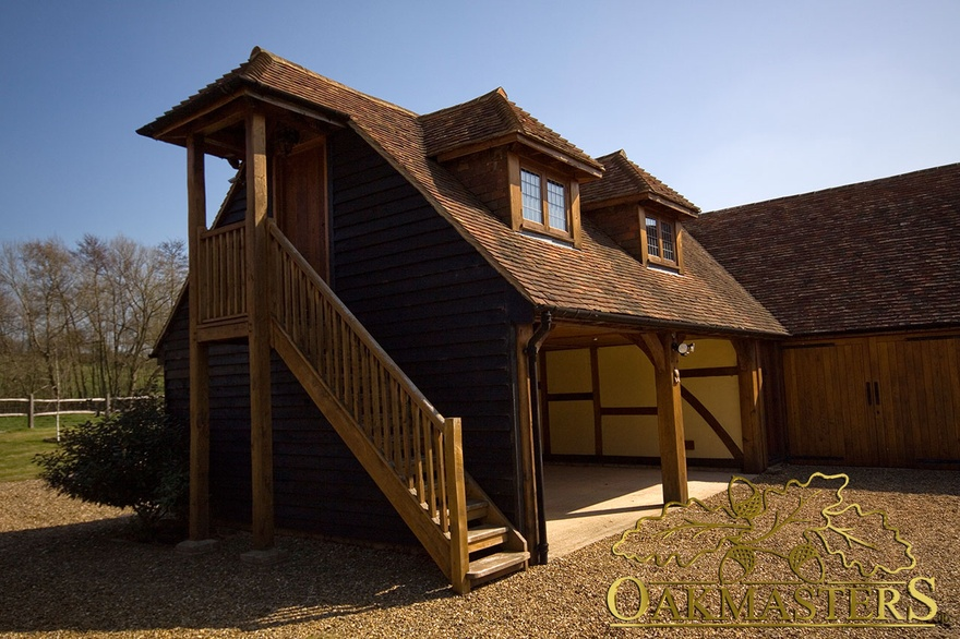 Large L Shaped Oak Framed Garage With External Staircase