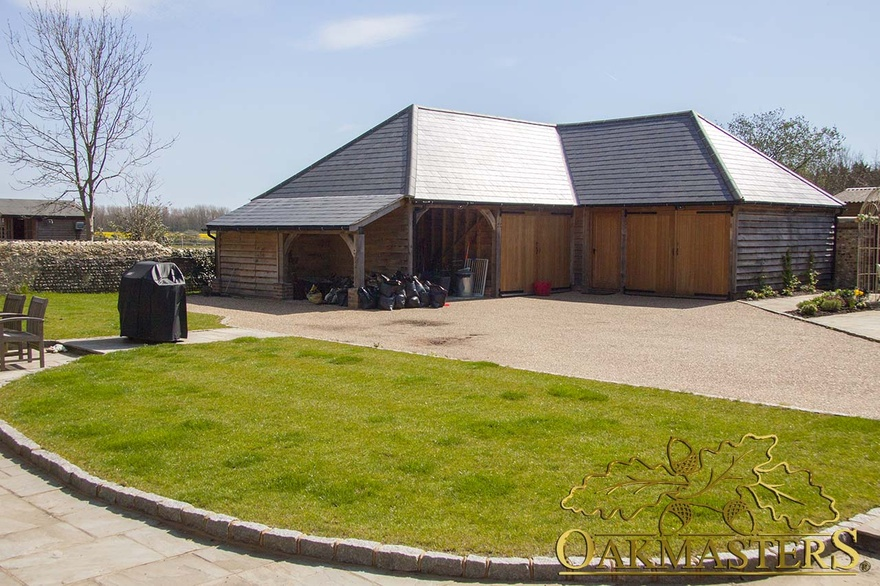 l shaped garage and outbuilding with utility room and gym
