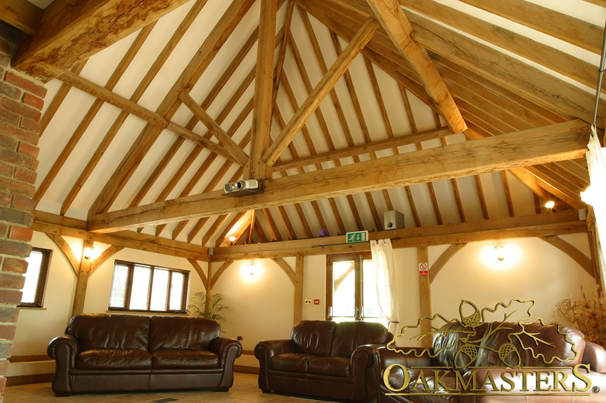Exposed rafters and oak kingpost truss in large corporate entertainment suite