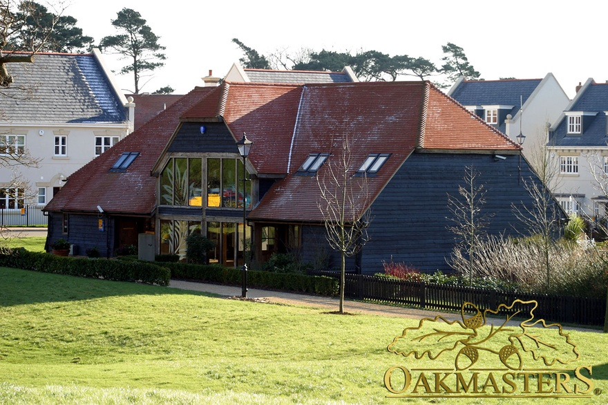 Oak clad and tiled roof marketing suite with large oakframe glazed window elevation