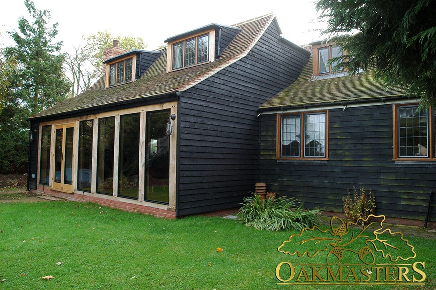 Exterior of oak frame and oak-clad sitting room extension