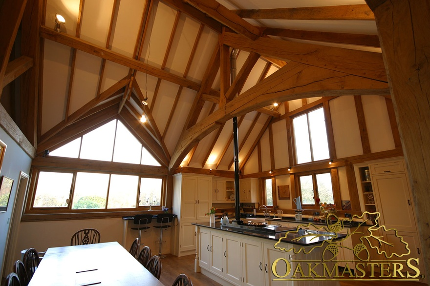 Inside Glazed Gable And Exposed Ceiling Rafters In Large Kitchen Dining Room Of Listed House Extension
