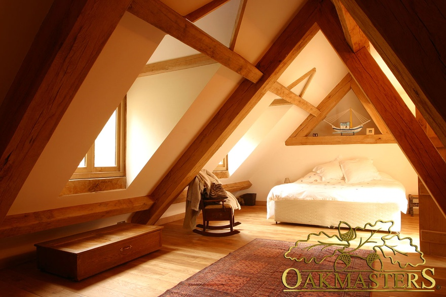 Oak framed loft bedroom with dormer window in country house extension