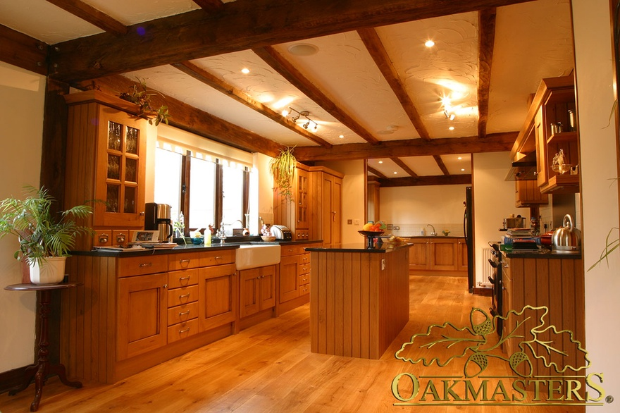 Simple straight oak beams in kitchen in oak and steel jointed house