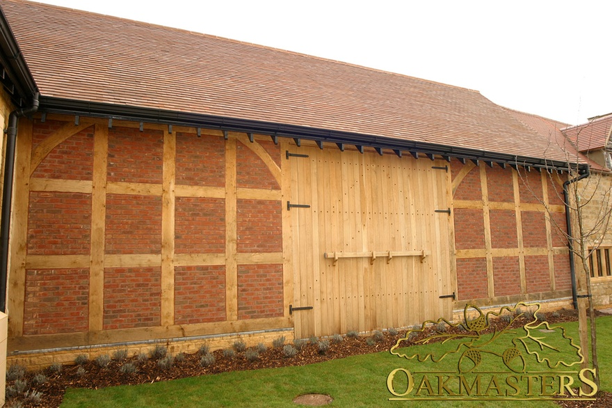 Exposed oak frame and double barn door with traditional door braces and latch on supermarket