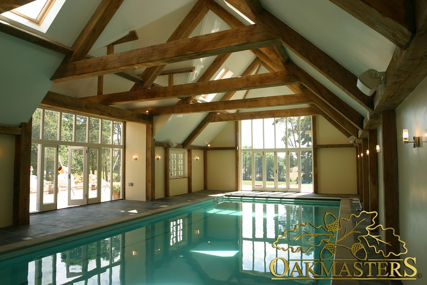 Oak pool building with raised tie trusses