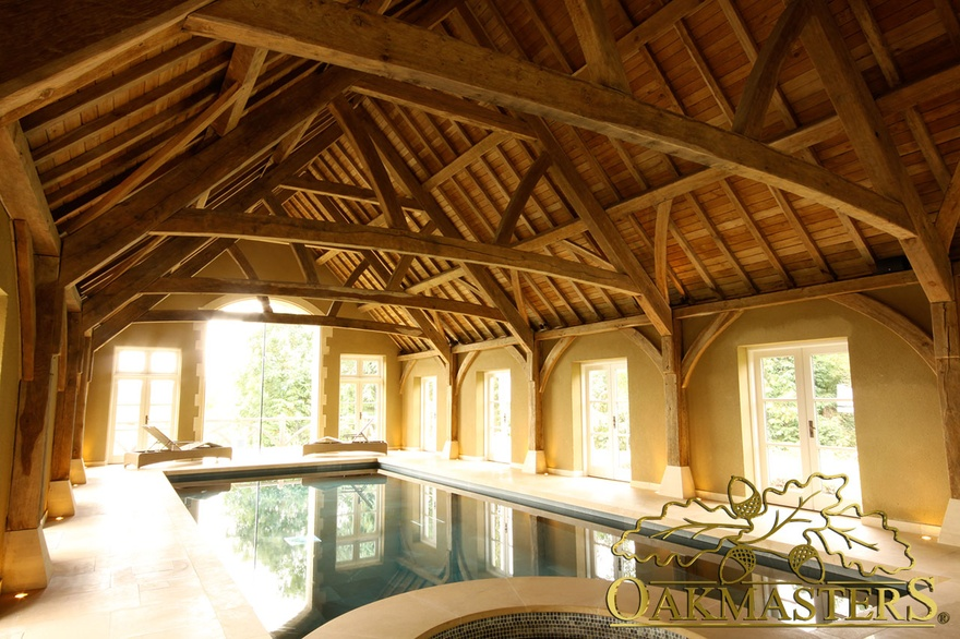 Fully exposed oak timber roof above swimming pool in large pool building