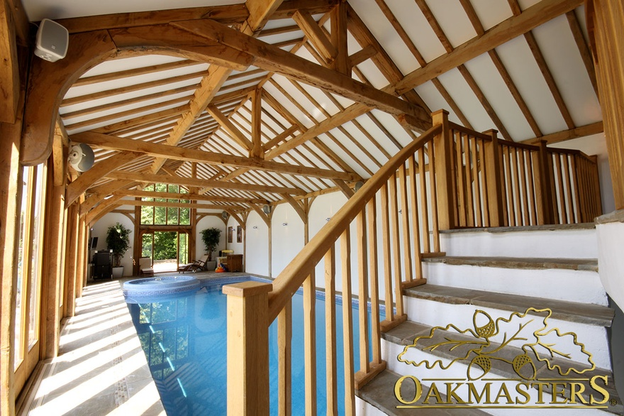 Internal gallery stairs and large exposed oak frame vaulted ceiling in pool house