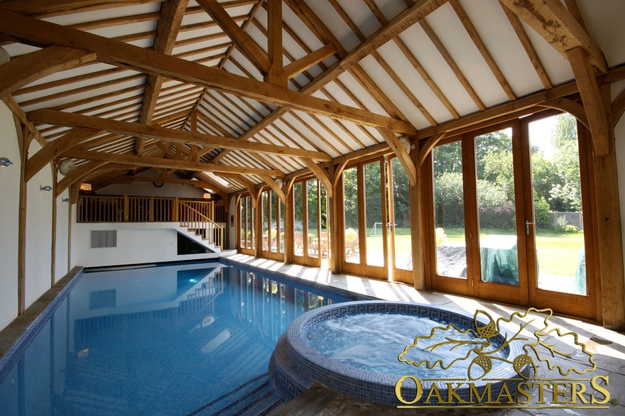 Vaulted oak pool house with internal gallery oakmasters for Building a swimming pool in garden