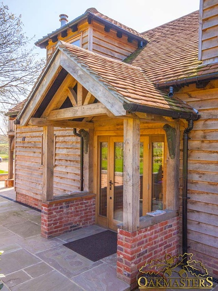 Small oak porch with a king post truss and red tiled roof
