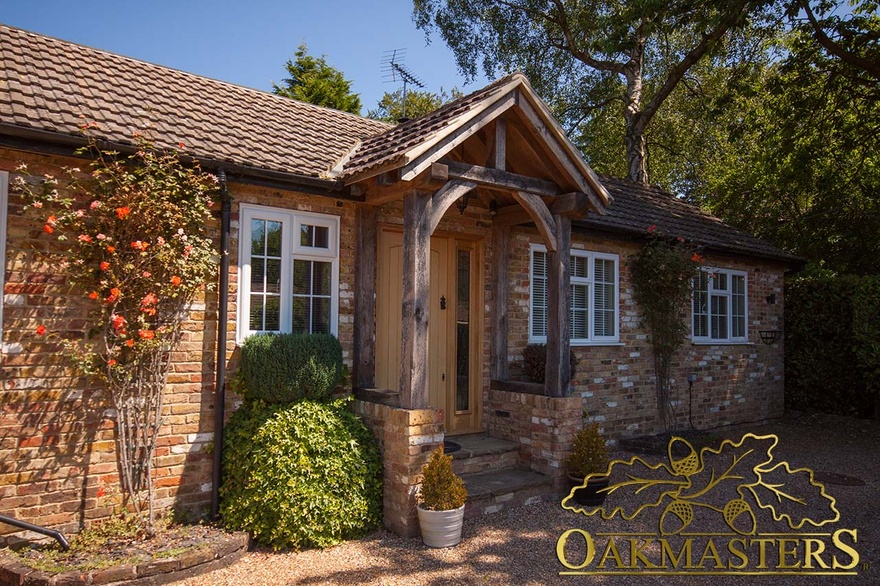 Traditional oak porch on a small brick cottage