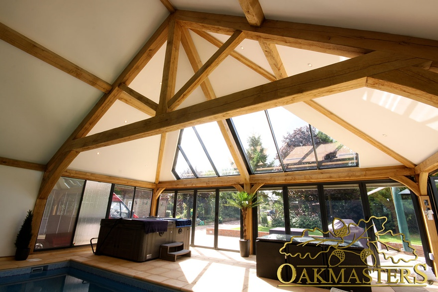 Trusses and roofs for extra head room oakmasters for Vaulted ceiling with exposed trusses
