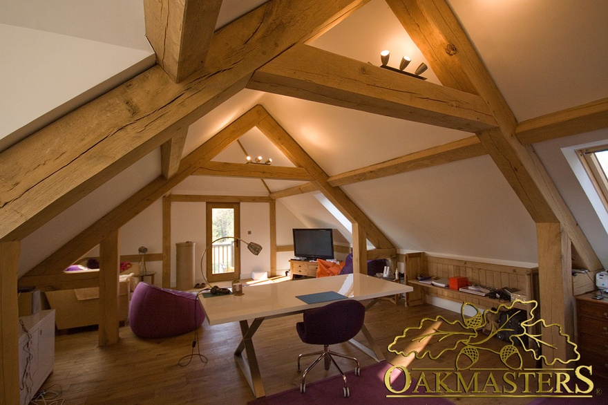 Oak queen post trusses in a contemporary loft office