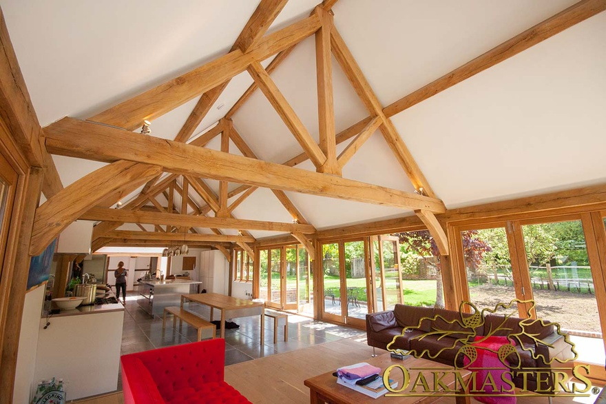 King post trusses and open vaulted ceilings oakmasters for Exposed roof trusses images