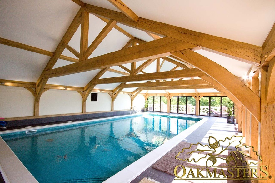 Raised tie truss in swimming pool room 5535 oakmasters for Pool room design uk
