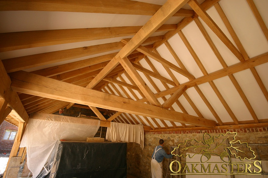 Exposed oak truss and open ceiling during build 5594 for Vaulted ceiling with exposed trusses