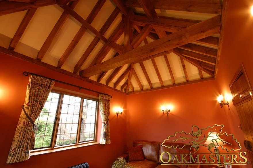 Exposed king-post truss and open ceiling in country sitting room