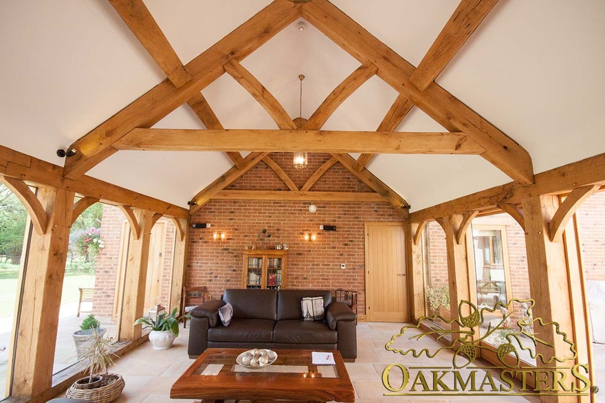 Glazed link room as sitting room with exposed traditional truss