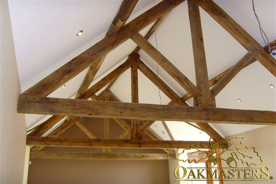 King post truss in open vaulted ceiling
