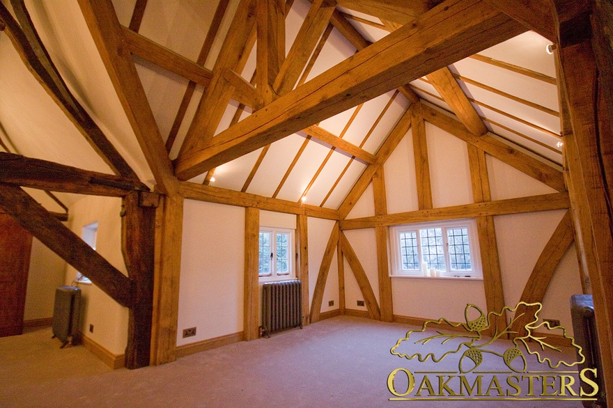 New king post truss and vaulted ceiling extension integrates with period part of hallway
