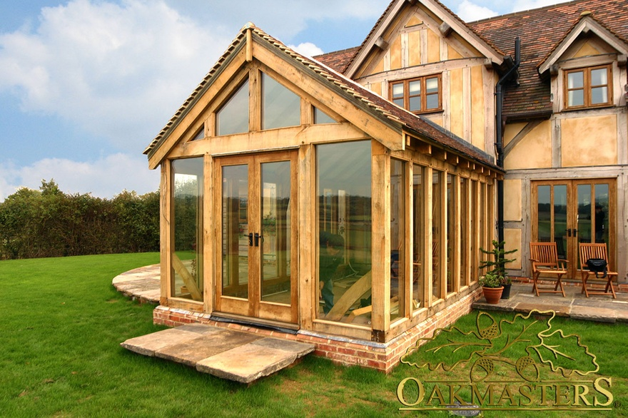Exterior glazed gable and oak frame doors leading out of for Oak framed garden room