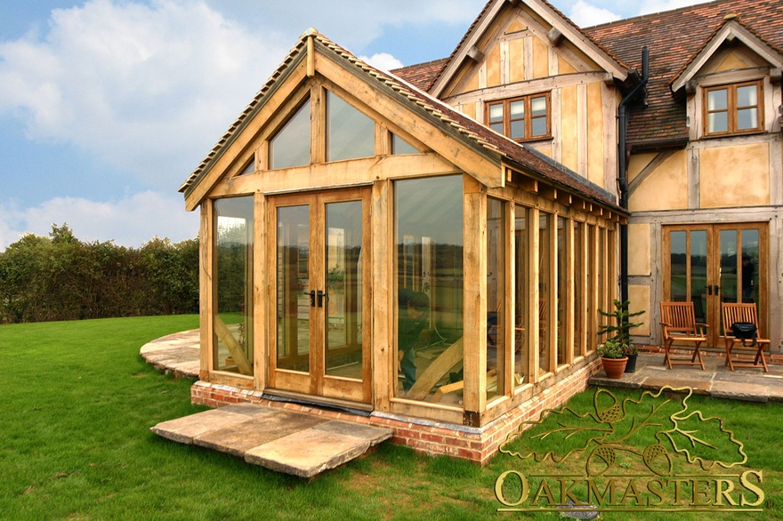 Oak garden room built to match an existing house oakmasters for Timber garden rooms