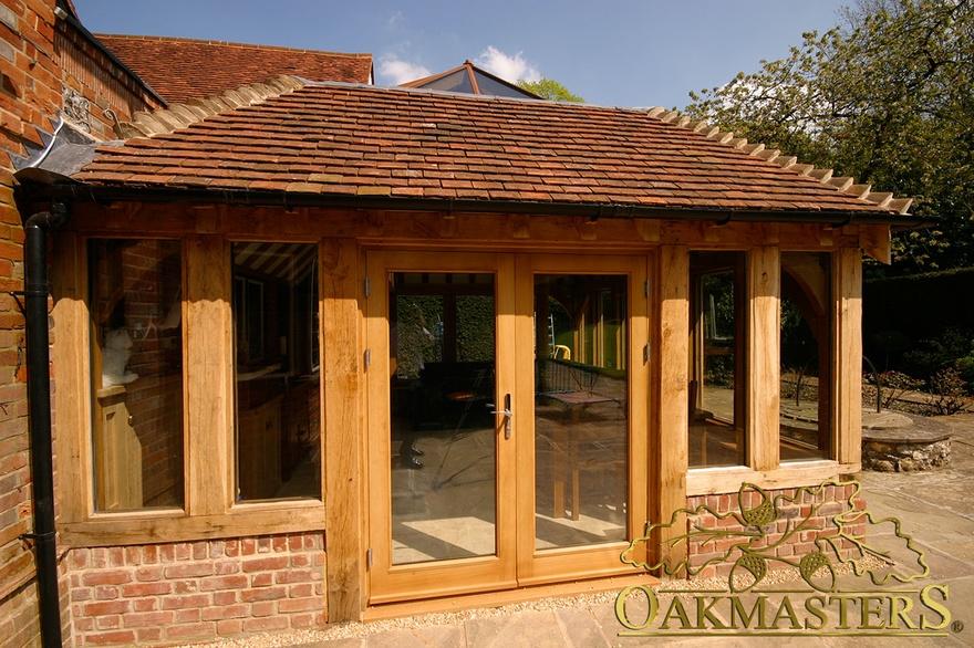 Oak frame glazed doors and glass lantern orangery roof on for Oak garden rooms