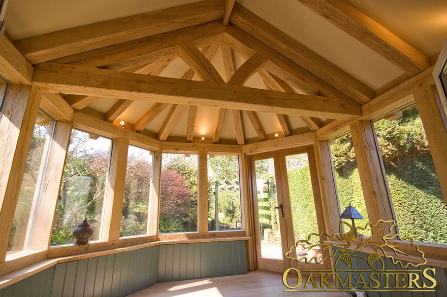Interior hexagonal garden room with exposed timber rafter for Garden rooms kent