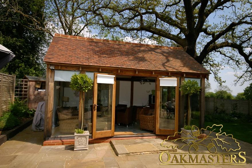 Small glazed garden room with patio doors 5721 oakmasters for Oak garden rooms