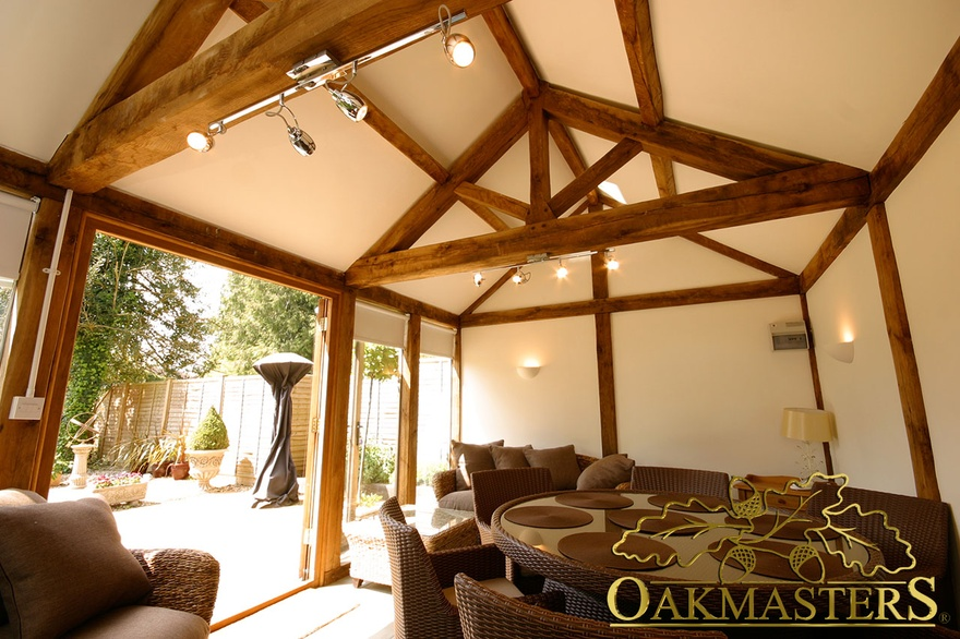 Open ceiling in small glazed garden room maximises space