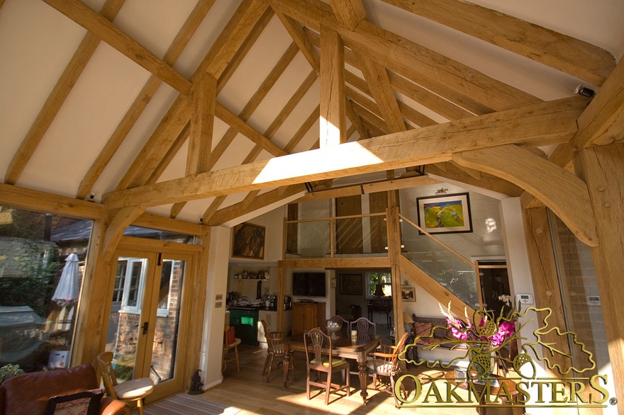 Handcrafted oak truss exposed rafters and oak staircase in garden room