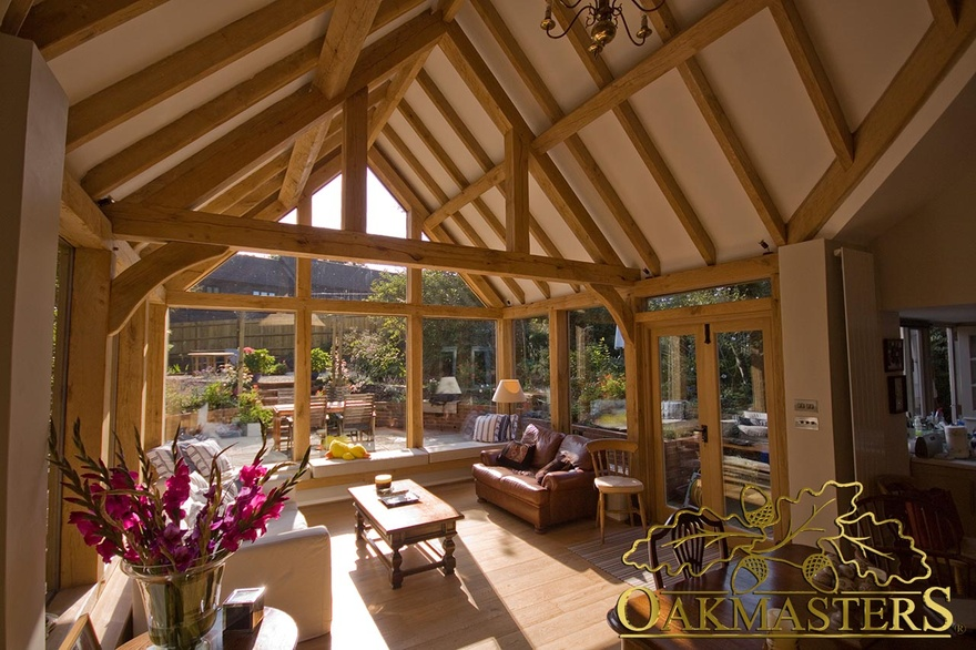 Queen post truss and vaulted ceiling to increase height for Garden rooms finance
