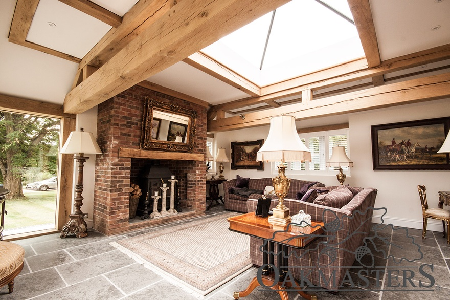 Traditional oak and brick fireplace with wood burning stove