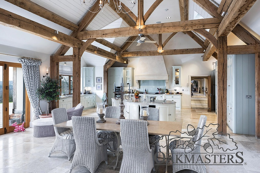 Manor house dining area with open vaulted oak roof