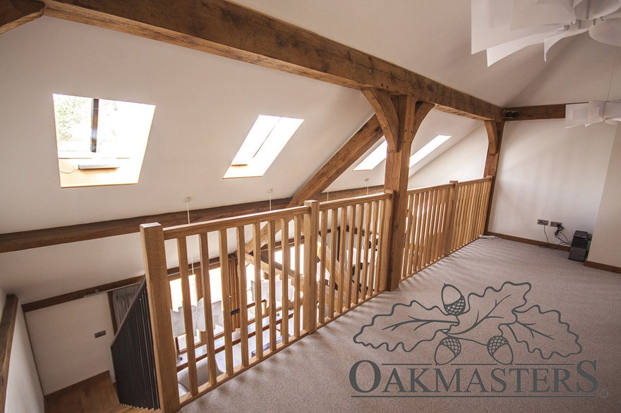 Top of the staircase opens onto a large landing with oak posts and brackets