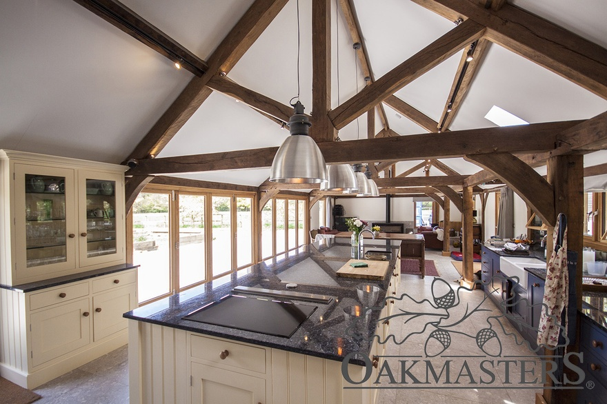 Open plan kitchen with exposed oak king post trusses