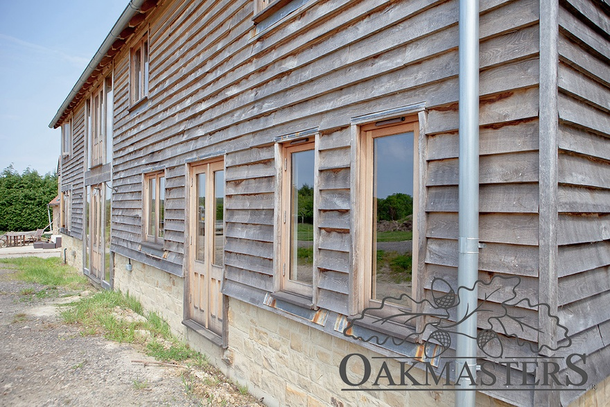 The barn is clad with oak feathr edge cladding all around