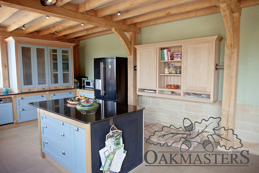Hand made oak kitchen units  are integrated into the frame in places