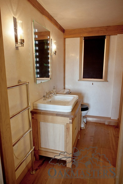 Visible oak frame detail in one of the en-suite bathrooms