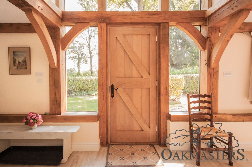 Create a grand entrance with an integrated glazed oak porch.