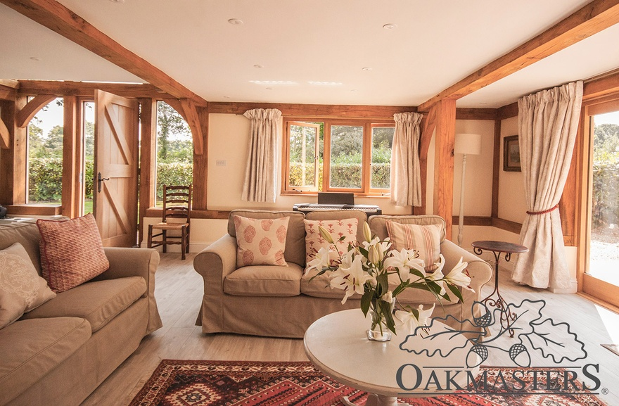 Cosy sitting room with a few oak beams overhead.