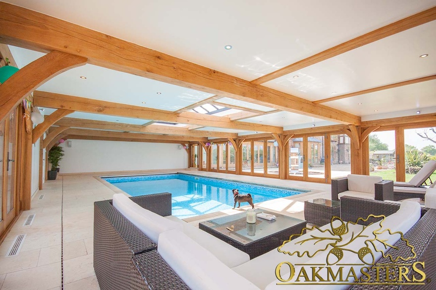 Oak framed swimming pool building with low profile flat roof