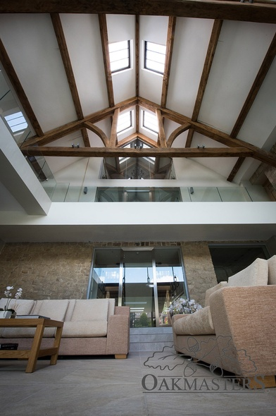 Looking up from the swimming pool, you get a stunning view of the vaulted oak roof